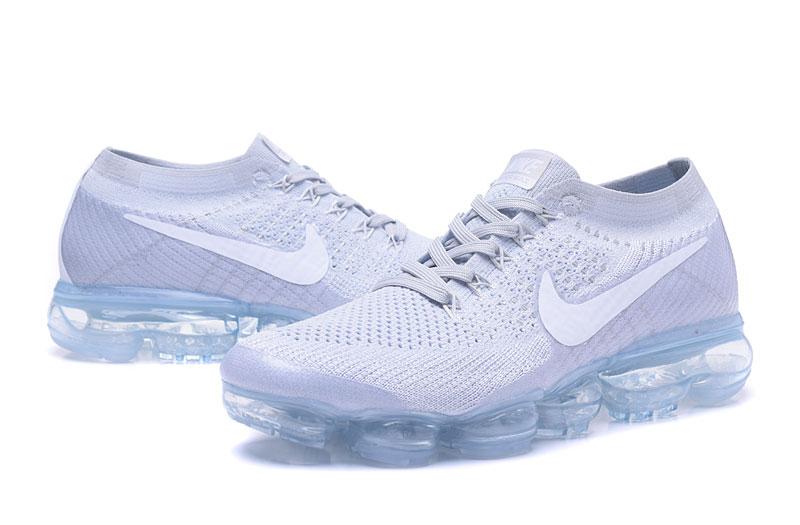 white vapormax blue sole